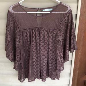 Layering top. Lace material. Brown in color